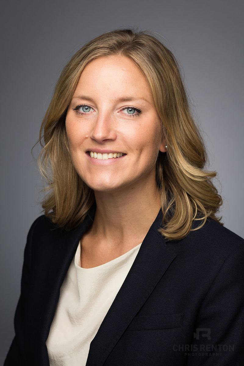 corporate headshots female grey backdrop