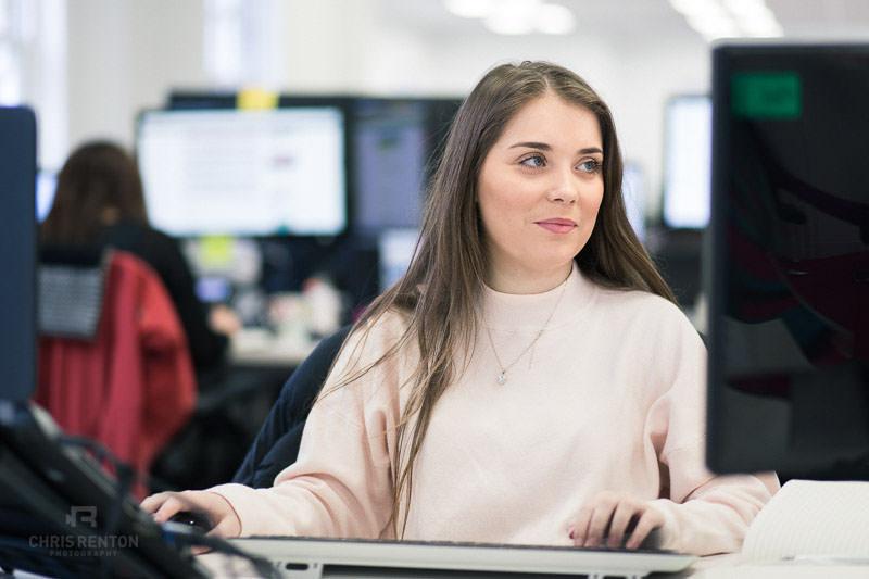 corporate portrait desk young female