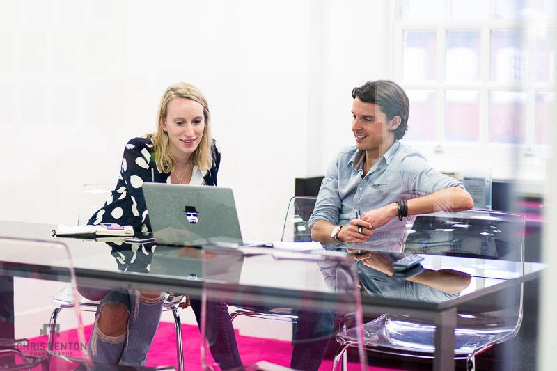 tech company meeting male female reflections