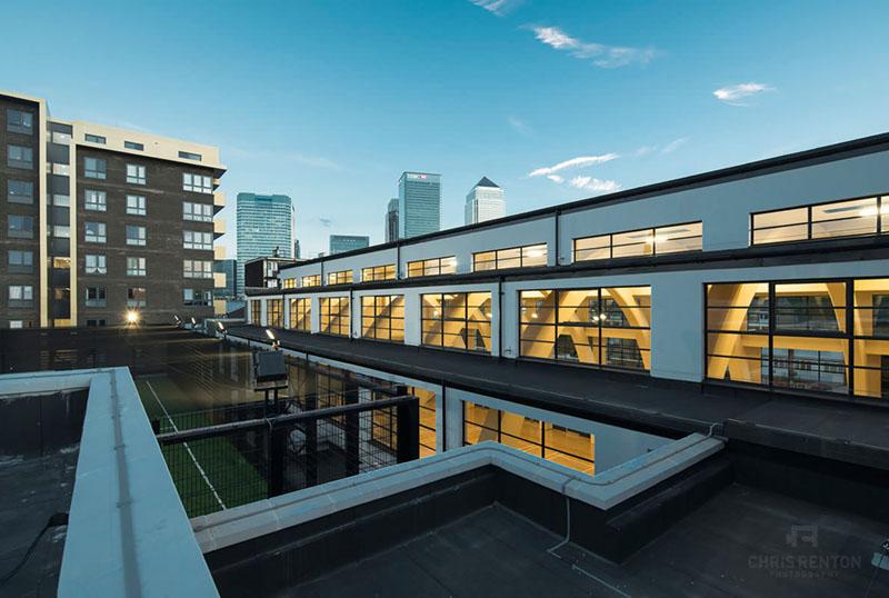 Poplar Baths London exterior view of Canary Wharf